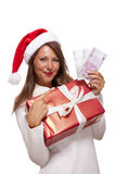 Young woman with an Xmas gift and money Stock Photo