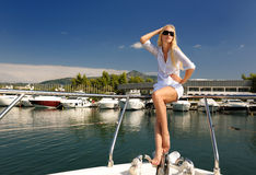 Young woman on the yacht. The beautiful young woman on the yacht Stock Photo