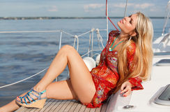 Young woman on the yacht. Picture of sexy young woman sitting on the yacht Stock Photography