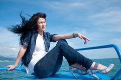 A  young woman on a yacht at sea Stock Photography