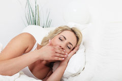 Young woman yawning Stock Images