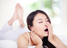Young woman yawning in bed in the morning Royalty Free Stock Photography