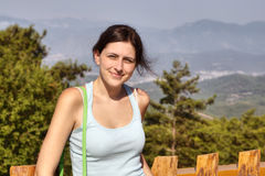 Young woman 19 years old, against backdrop of mountain scenery. Royalty Free Stock Photography