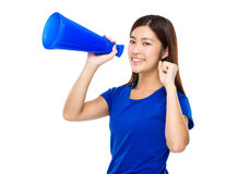 Young Woman yell with megaphone Stock Photo