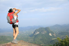 Young woman yelling at mountain peak Stock Photo