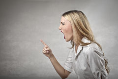 Young woman yelling Stock Photos