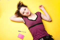 Young woman on yellow Stock Image