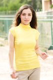 Young woman in yellow Royalty Free Stock Photography