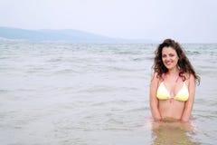Young woman in yellow bikini swimming in the sea Royalty Free Stock Images