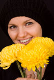 Young woman with yellow chrysanthemums Stock Images