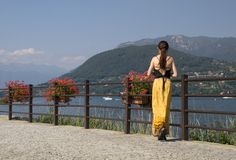 Young woman in yellow dress. On the Lake Orta (Italy stock image