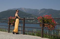 Young woman in yellow dress. On the Lake Orta stock photography