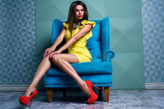 Young woman in yellow dress stock photography