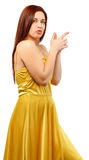 Young woman in yellow dress point finger showing something to si Stock Images