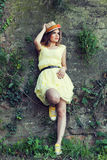 Young woman in yellow dress posing against old wall Royalty Free Stock Image