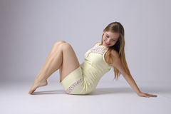 Young woman in yellow dress Royalty Free Stock Image