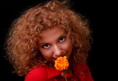 Young woman with yellow flower Royalty Free Stock Photos