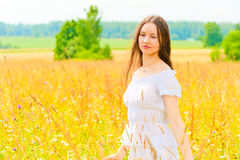 Young woman in yellow flower field Royalty Free Stock Photos