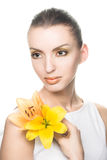 Young woman with yellow flowers. Portrait of young woman with yellow flowers Royalty Free Stock Photos