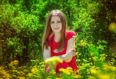 Young woman with yellow flowers Royalty Free Stock Photo