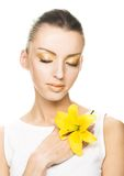 Young woman with yellow flowers Stock Photo