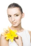 Young woman with yellow flowers Royalty Free Stock Photos
