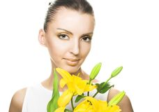 Young woman with yellow flowers Stock Images