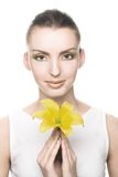 Young woman with yellow flowers Royalty Free Stock Images