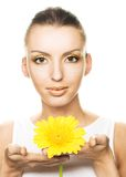 Young woman with yellow flowers Stock Photography