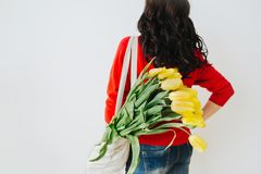 Young woman with yellow flowers. stock images