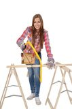 Young woman with yellow Hacksaw Stock Photo