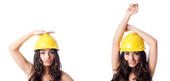 The young woman with yellow hard hat on white Royalty Free Stock Photo