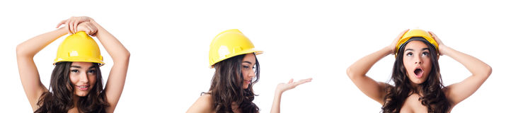 The young woman with yellow hard hat on white Royalty Free Stock Images