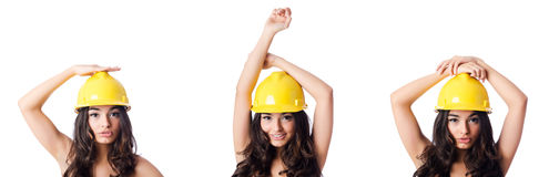 The young woman with yellow hard hat on white Royalty Free Stock Image