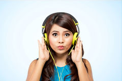 Young woman with yellow headphone,  Stock Photos