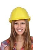Young woman with a yellow helmet. Close-up of an attractive young woman with a yellow helmet Royalty Free Stock Images