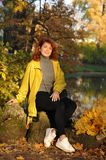 Young woman in a yellow jacket stock photos
