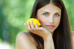 Young woman with yellow lemon stock image