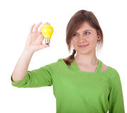 Young woman with yellow lightbulb Royalty Free Stock Photography
