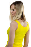 Young woman with yellow makeup from back Stock Image