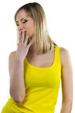 Young woman with yellow makeup Stock Images