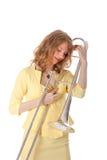 Young woman in yellow mini dress holding trombone Royalty Free Stock Photo