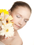 Young woman with yellow orchid Royalty Free Stock Photos