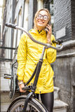 Woman with bicycle near the house entrance Royalty Free Stock Image