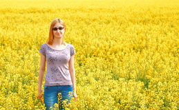 Young Woman In Yellow Rape Field Stock Image
