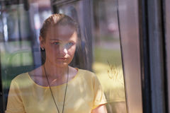 Young woman in yellow rides the bus Stock Images