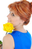 Young woman with a yellow rose. Royalty Free Stock Photography