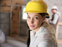 Young woman with yellow security helmet Royalty Free Stock Photos