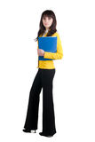 Young woman in yellow suit with the office folder. Stock Photography