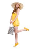 Young woman in yellow summer dress isolated on the Royalty Free Stock Images